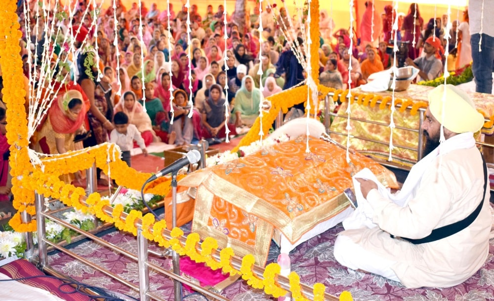 <p>Sikh devotees attend a religious festival  to celebrate the 549th birth anniversary of their spiritual leader Baba Guru Nanak, at Guru Nanak School auditorium in Ranchi on…