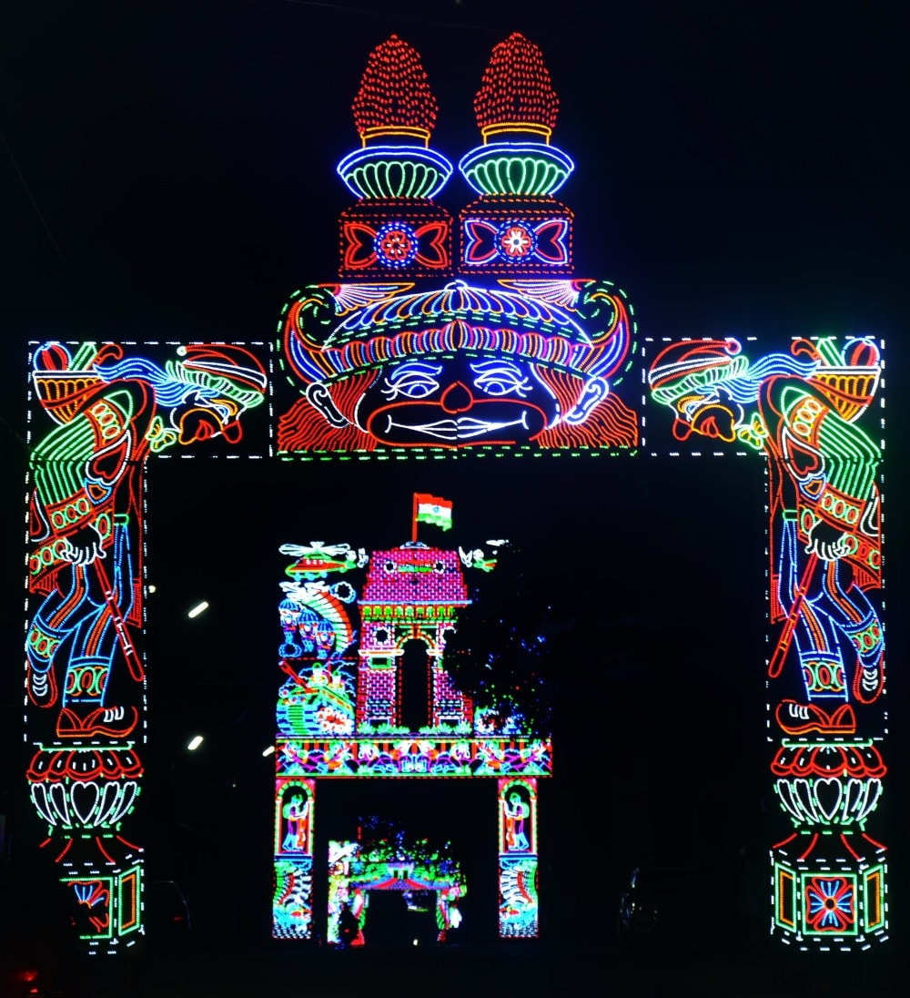<p>Characteristic neon lights glow as late night revellers throng the streets of Kokar in Ranchi on Tuesday.</p>