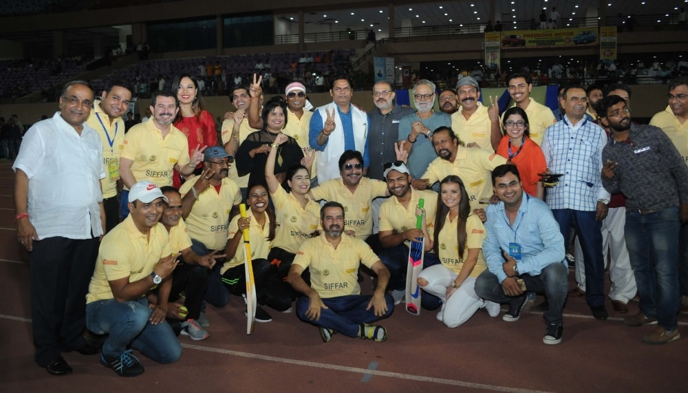 <p>Celebrity XI and CS XI team members and officials pose for photographs during their cricket match during the second day of 1stJharkhand International Film Festival Award 2018,at…