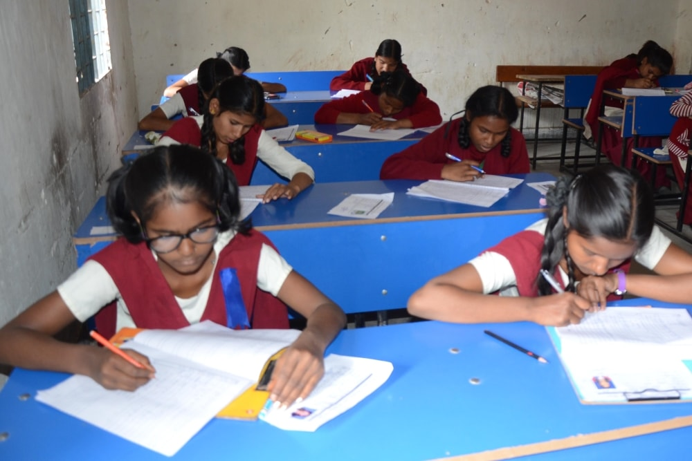 <p>Students appearing for class 8th Jharkhand Academic Council (JAC) Board examinations at a school in Ranchi on Tuesday. </p>