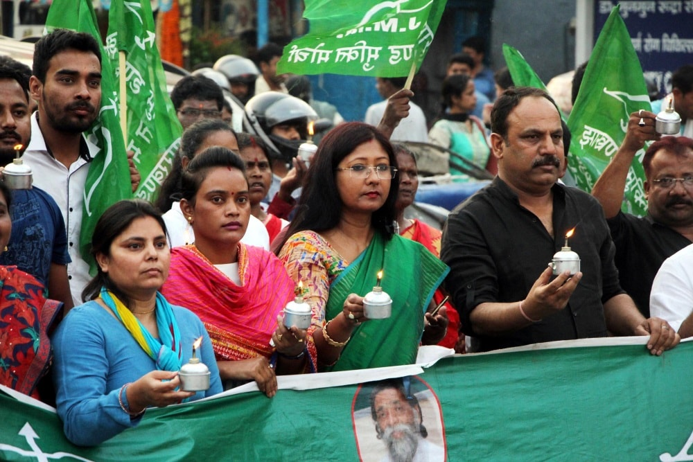 <p>Jharkhand Mukti Morcha (JMM) activists are seen holding kerosene oil diyas as they protest over problem of electricity, at Albert Ekka Chowk in Ranchi on Saturday.</p>