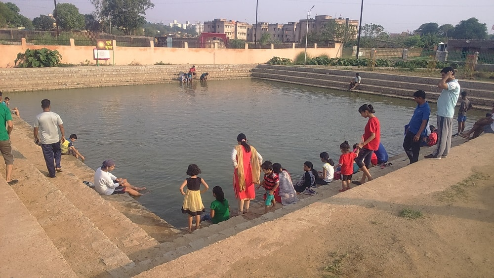 <p>Men,women and children undergo foot bathing,smiling and relaxing,a part of daily morning exercise at Suraj Kund pond inside Oxygen Park in Ranchi.</p>