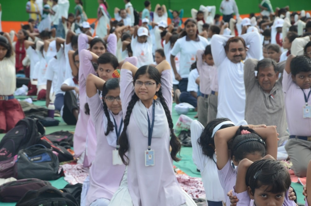 <p>People performingYoga during the 3rdInternational Yoga Day at Morhabadi ground in Ranchi on Wednesday.</p>