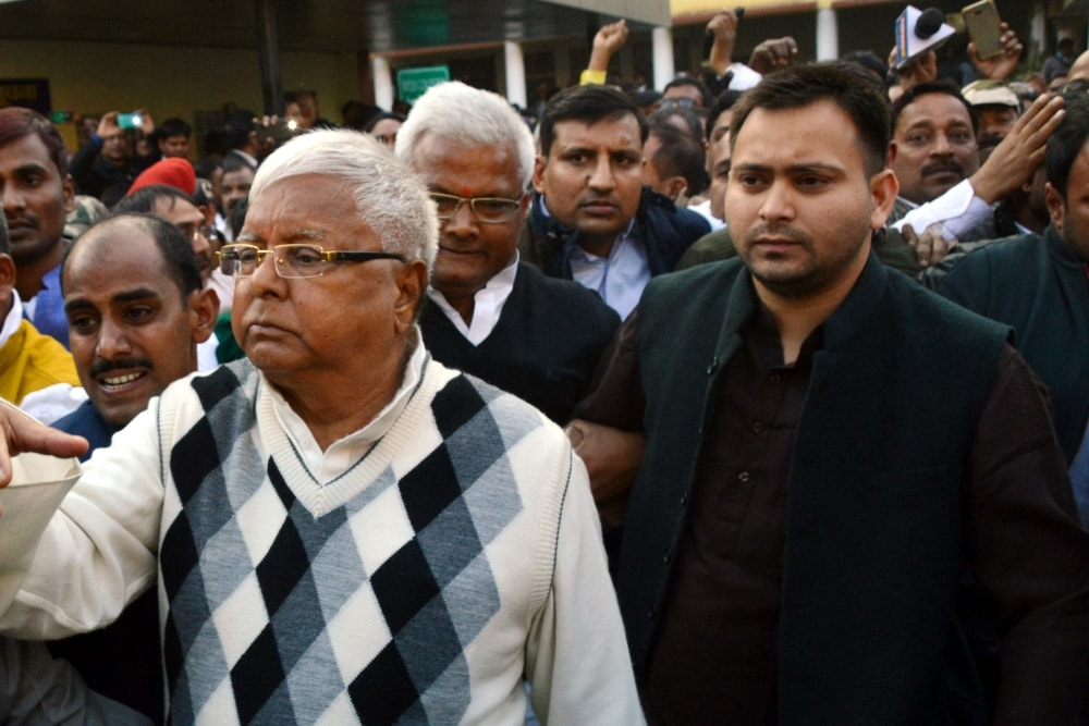 <p>Former Bihar Chief Minister and RJD Chief Lalu Prasad Yadav along with his son Tejaswi Yaday coming out after being convicted by the special CBI court in connection with the multi-crore…