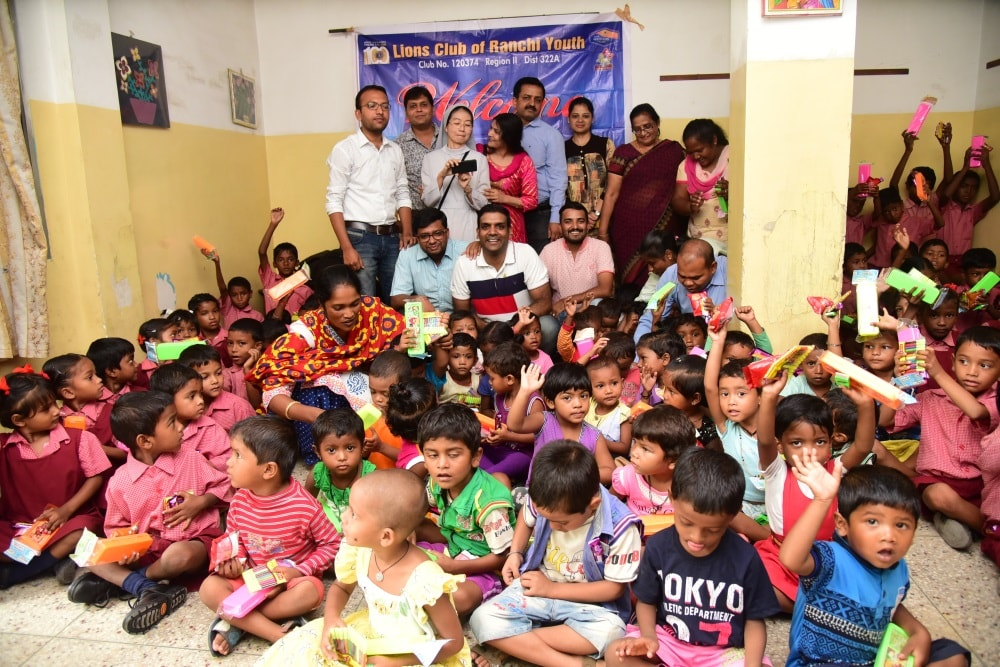 <p>Lions club of Youth Ranchi members celebrates Raksha Bandhan with poor children in Ranchi on Saturday.</p>