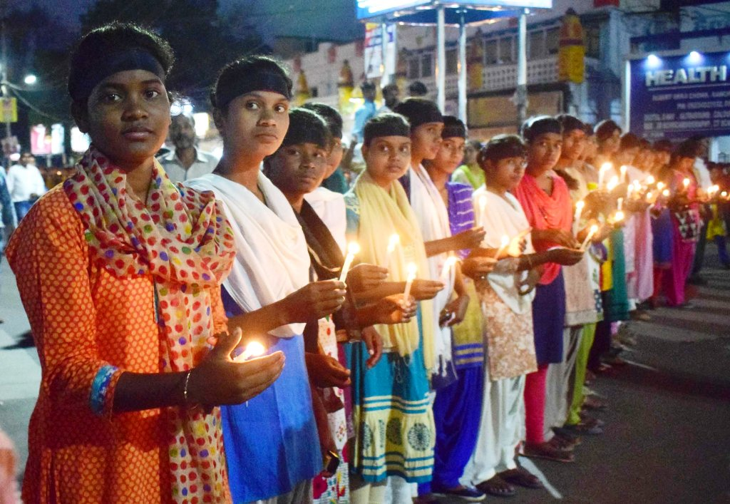 <p>Members of Scheduled caste and Scheduled tribe communities participating a candlelight protest against the Supreme Court's ruling on SC/ST Act, in Ranchi on Tuesday.</p>