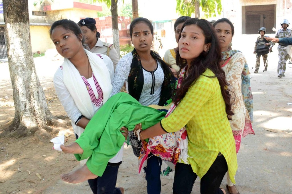 "<p>An injured student being shifted by college students for medical treatment during ""Bharat Bandh"" called given by Dalit organizations against the alleged dilution of scheduled…"