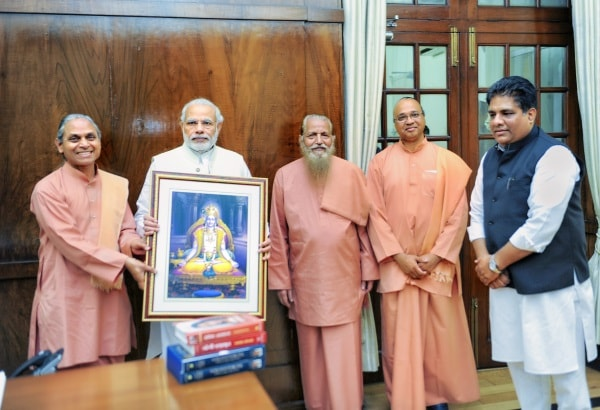 <p>YSS devotees with Prime Minister Narendra Modi who had released a postal stamp in 2016 to commemorate the 100 years of Yogda Satsang Society of India which was founded by Paramahansa…