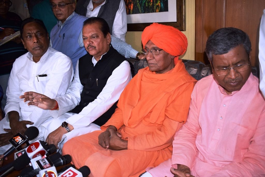 <p>Social activistSwami Agnivesh along with JVM Chief Babulal Marandi, Congress senior leader Subodh Kant Sahay and other Opposition parties leaders join hands after a press…