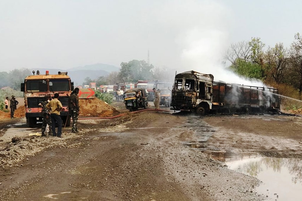 "<p>A truck set on fire by a group of protesters during ""Bharat Bandh"" call given by Dalit organizations against the alleged dilution of scheduled castes / scheduled…"