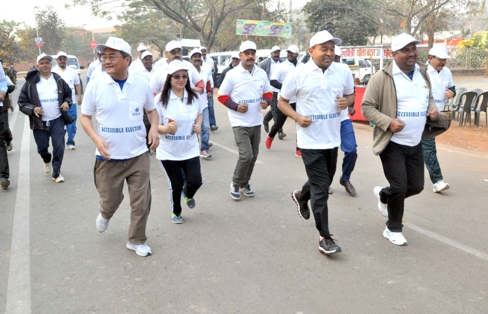 <p>Chief electoral officer L Khiante along with Ranchi DC Manoj Kumar and others take part in a National Voters' Day at Morhabadi Ground in Ranchi on Wednesday. </p>