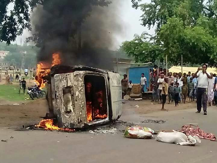 <p>Members of a community torch a vehicle during a protest against lynching of a man by another community, near Bajartand village in Ramgarh district on Thursday</p>