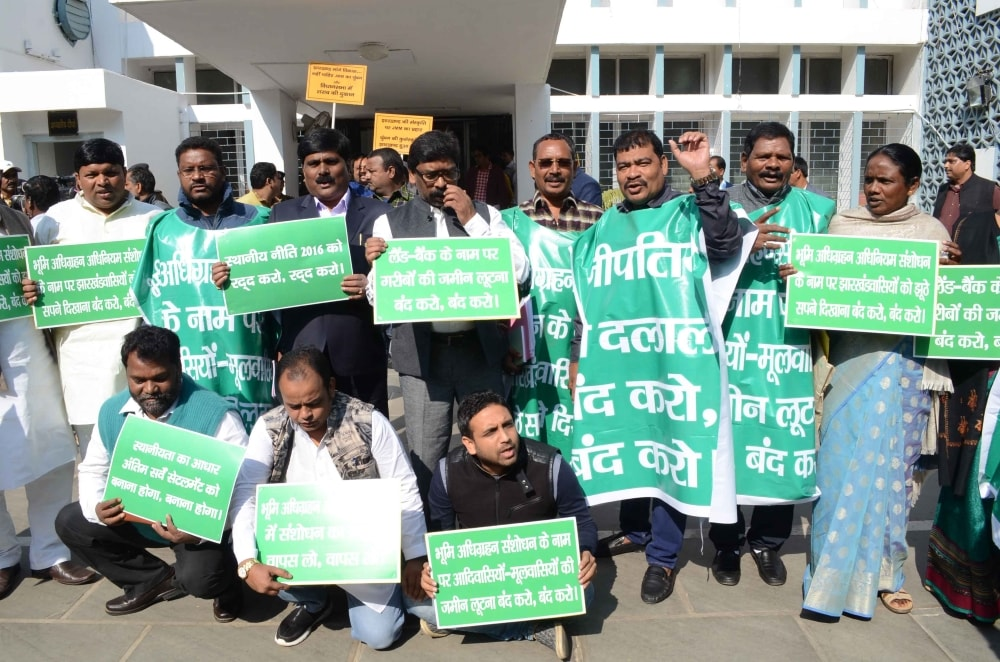 <p>Opposition party leader and JMM working President Hemant Soren along with parties legislators holds placards shouting slogans against the Governments CNT/SPT Act outside Jharkhand…