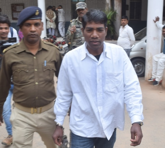 <p>25 year Gandhi Oraon escorted by police personnel after he was pronounced death sentenced by a special Protection of Children from Sexual Offences (POCSO) Court of Shiv Pal Singh…