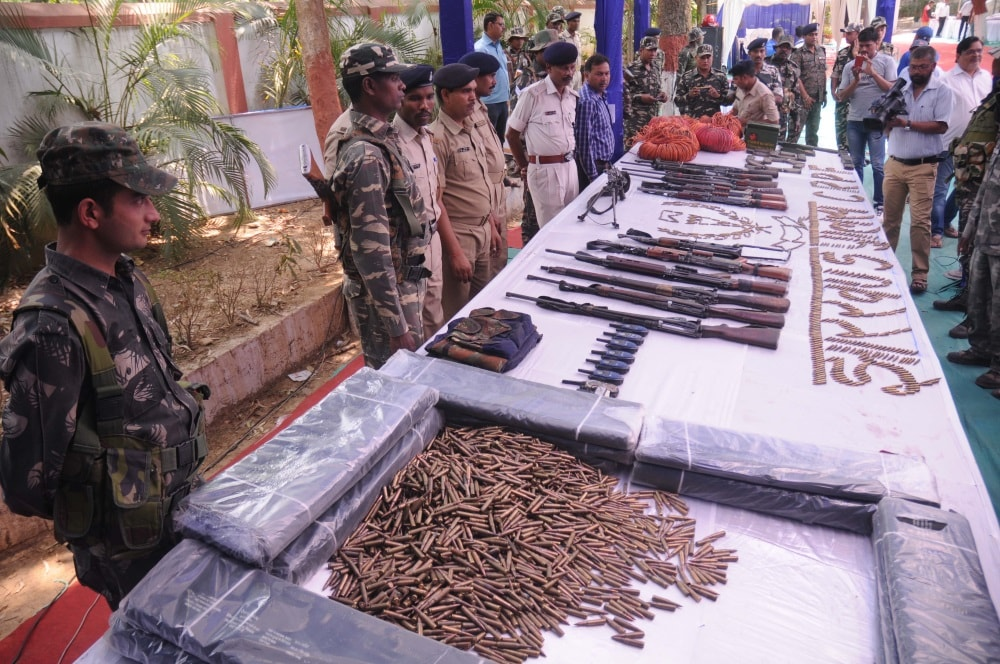 <p>Senior Police officials inspecting arms andammunitions recovered during a search operation from CPI Maoists' dens in Lohardaga on Thursday.</p>