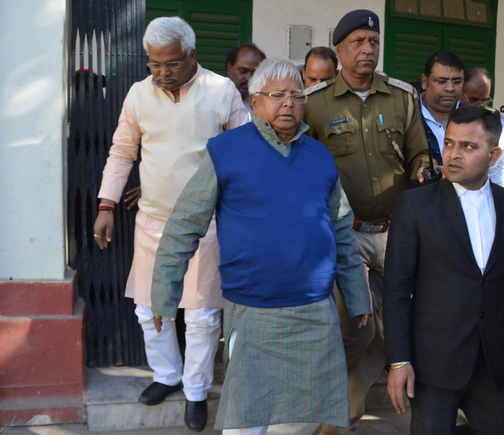 <p>Former Bihar Chief Minister and RJD Chief Lalu Prasad Yadav arrives to appear at a Special CBI court in connection with fodder scam cases in Ranchi on Thursday.</p>