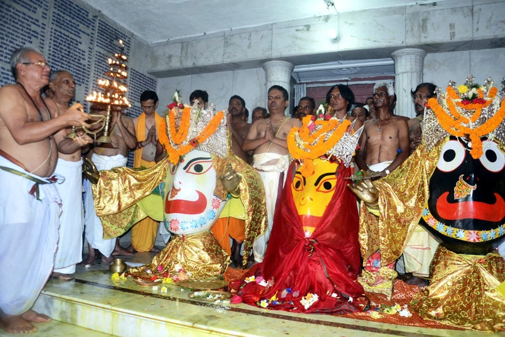 <p>Hindu priests pour milk over a statue of Lord Jagannath, Balabhadra, and Devi Subhadra during the Jal Yatra procession inside Jagannathpur temple in Ranchi on Thursday. </p>…