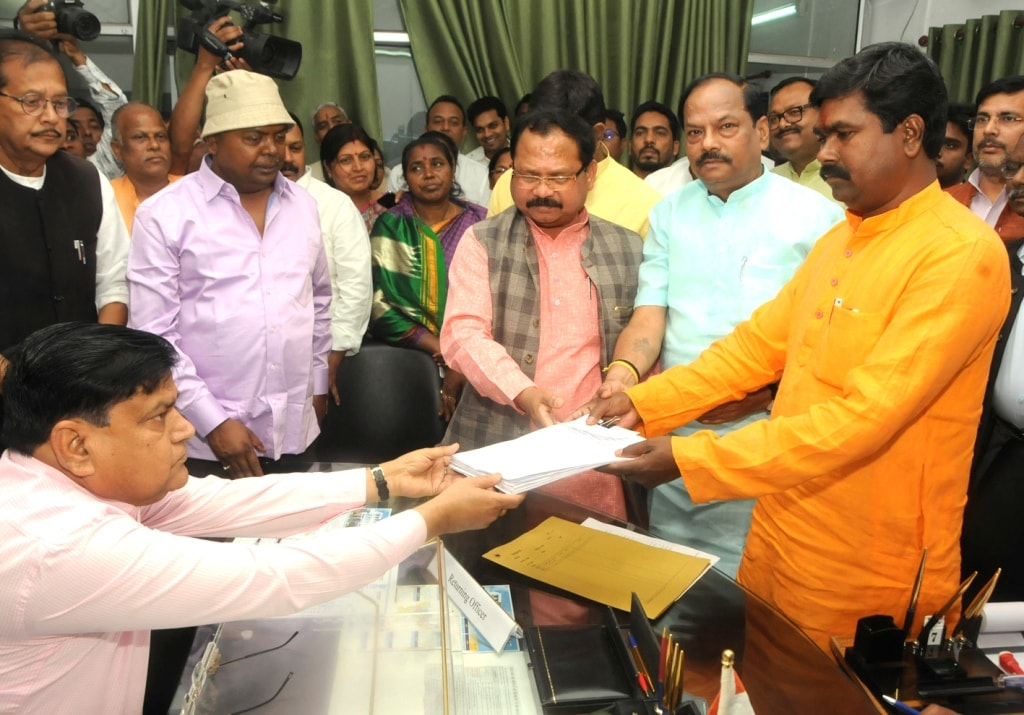 <p>Candidate for Bharatiya Janta Party (BJP) Samir Oraon filing his nomination papers for Rajya Sabha polls as Chief Minister Raghubar Das and State President Laxman Gilua, Minister…