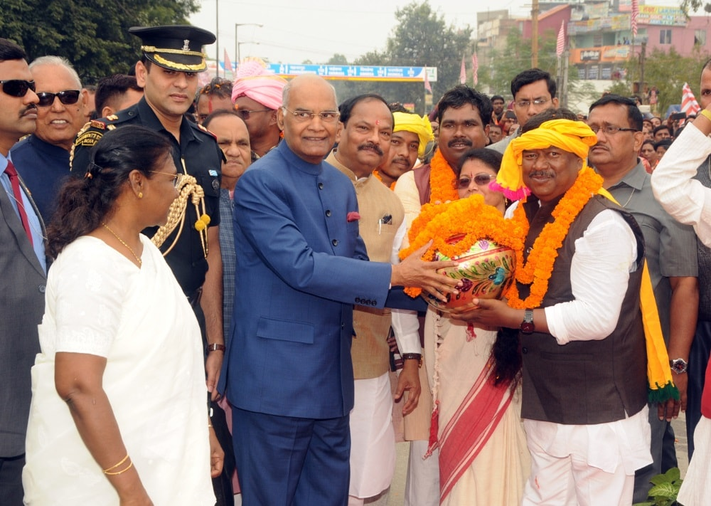 <p>Rural Development Minister (Gov.of Jharkhand) Neel Kanth Singh Munda presenting soil of Bhagwan Birsa Munda from Khunti,to President,Ram Nath Kovind, on the occasion of his birth…