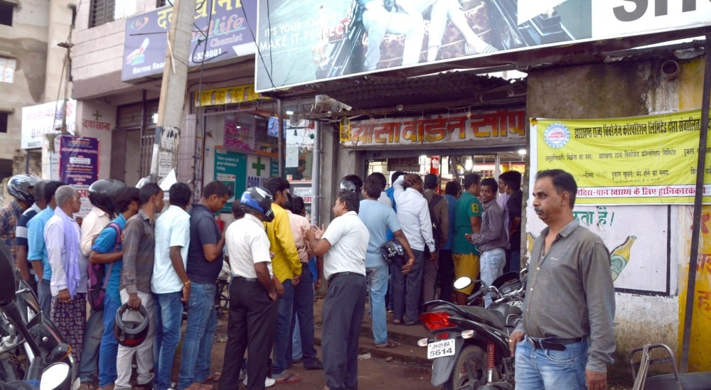 <p>At first glance the picture might remind you of people standing in queue outside ATM's after demonitization drive last year, but actually the people in the picture are standing…