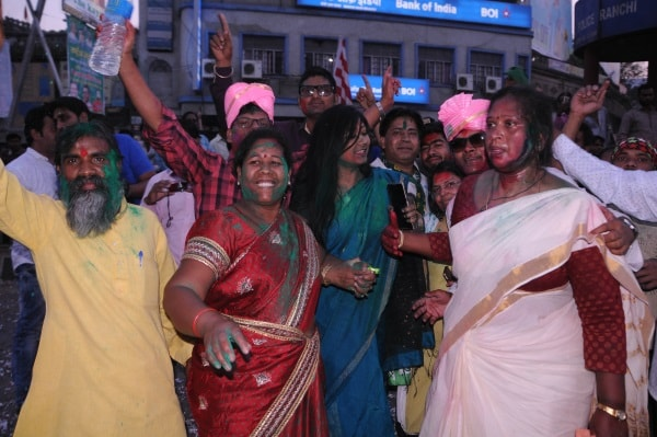 <p>Jharkhand Mukti Morcha party workers celebrating after win in Litipara by poll against the ruling BJP candidate</p>