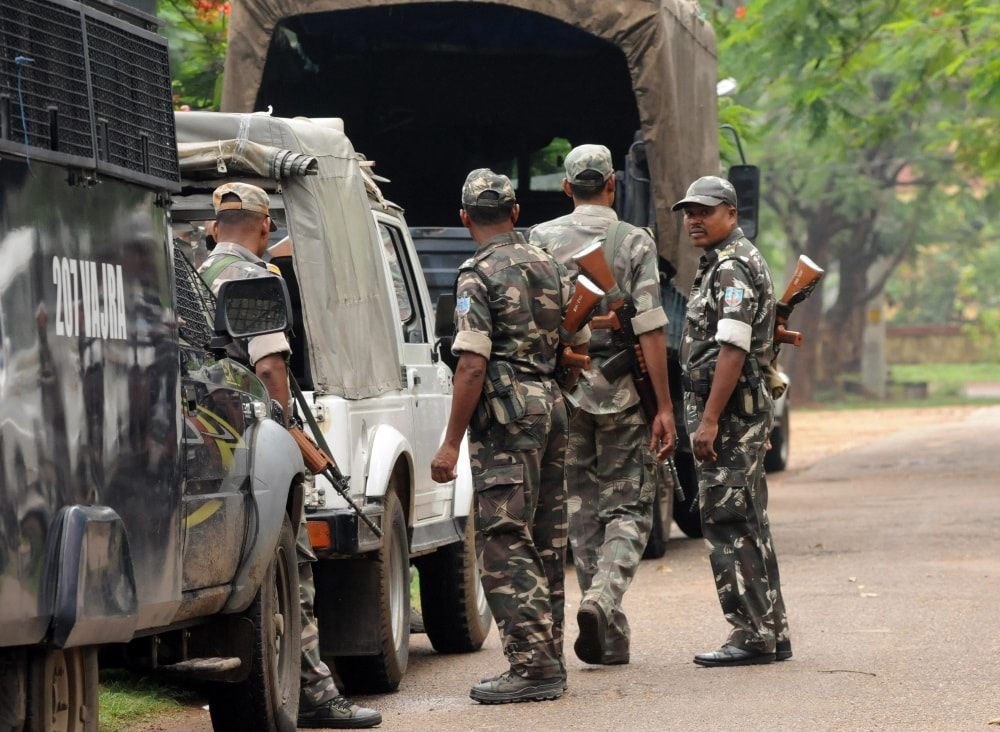 <p>Security forces outside Rajendra Institute of Medical Science (RIMS) hospital after two security forces died in an encounter with suspected Maoist groups at Karra forest under Khunti-Saraikela…