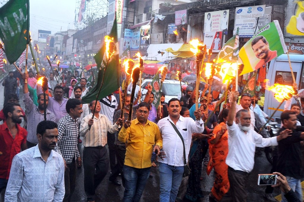 <p>Opposition party leaders take out a torchlight rally on the evening of the Jharkhand Bandh, called by all Opposition against amendments done into the Land Acquisition Act, 2013,…