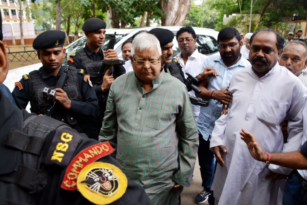<p>RJD Chief and former Bihar Chief Minister Lalu Prasad Yadav at a special CBI court in connection with Multi-Crore fodder scam cases in Ranchi on Friday. </p>…