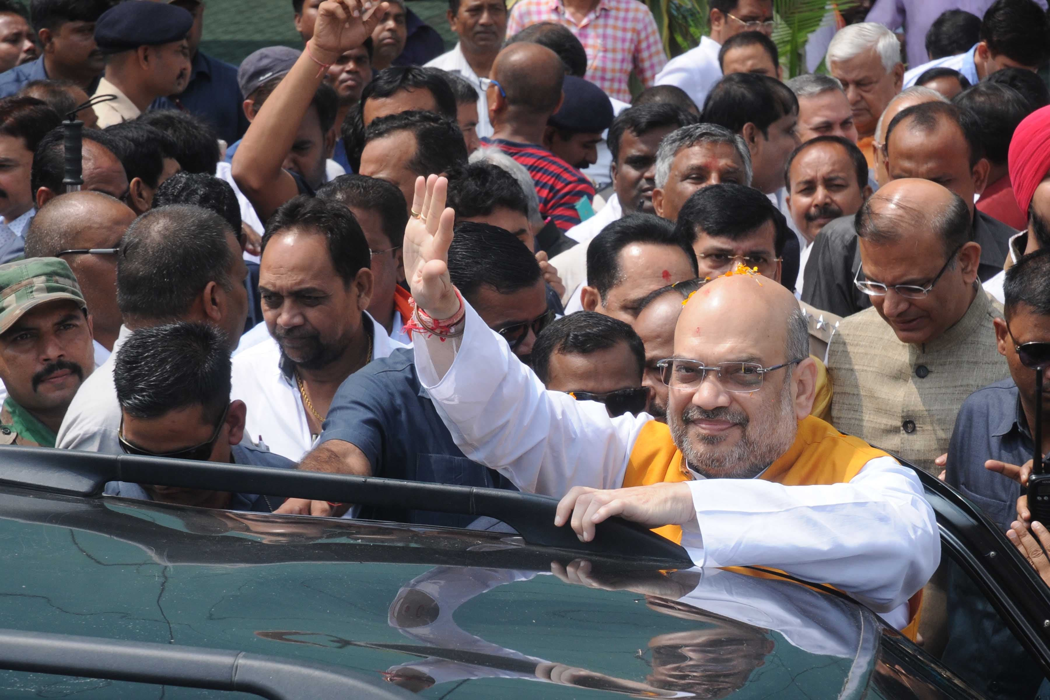 <p>BJP National President Amit Shah waves at crowd after paying tribute to freedom fighter Bhagwan Birsa Munda at Birsa Chowk in Ranchi on Friday.</p>
