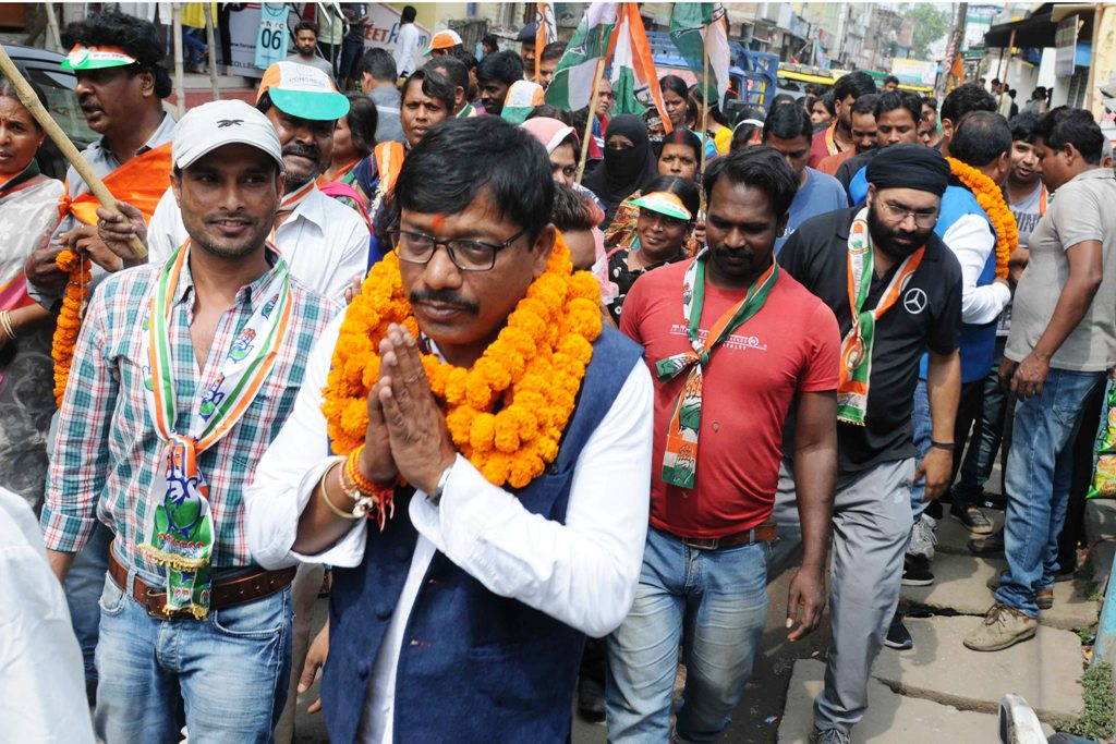 <p>Congress party candidate for Deputy Mayor Rajesh Gupta in a road show ahead of Ranchi Municipal Corporation elections at Chutia in Ranchi on Sunday.</p>