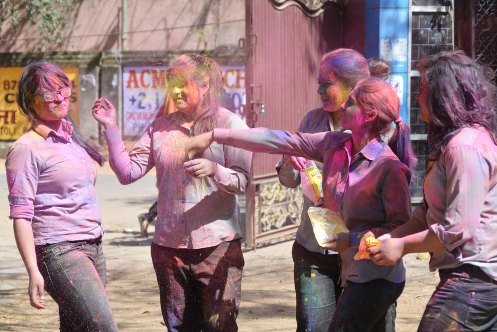 <p>Students smearing each other with colorful gulal to celebrate Holi festival at Women's college in Ranchi on Tuesday</p>