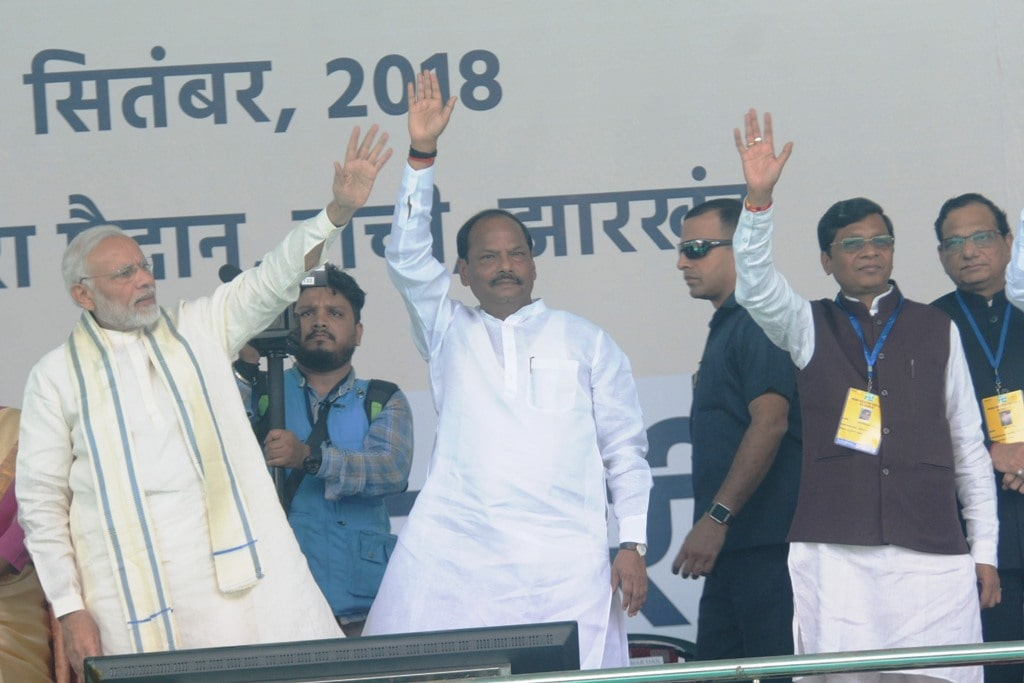 <p>Prime Minister Narendra Modi, Jharkhand Chief Minister Raghubar Das and MoS for Tribal affairs Minister Sudarsan Bhagat waves a gathering during launching ceremony of…