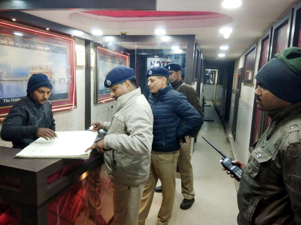 <p>Police officials conduct a security investigation at a hotel on the eve of the Republic Day function at Station road in Ranchi on Thursday.</p>