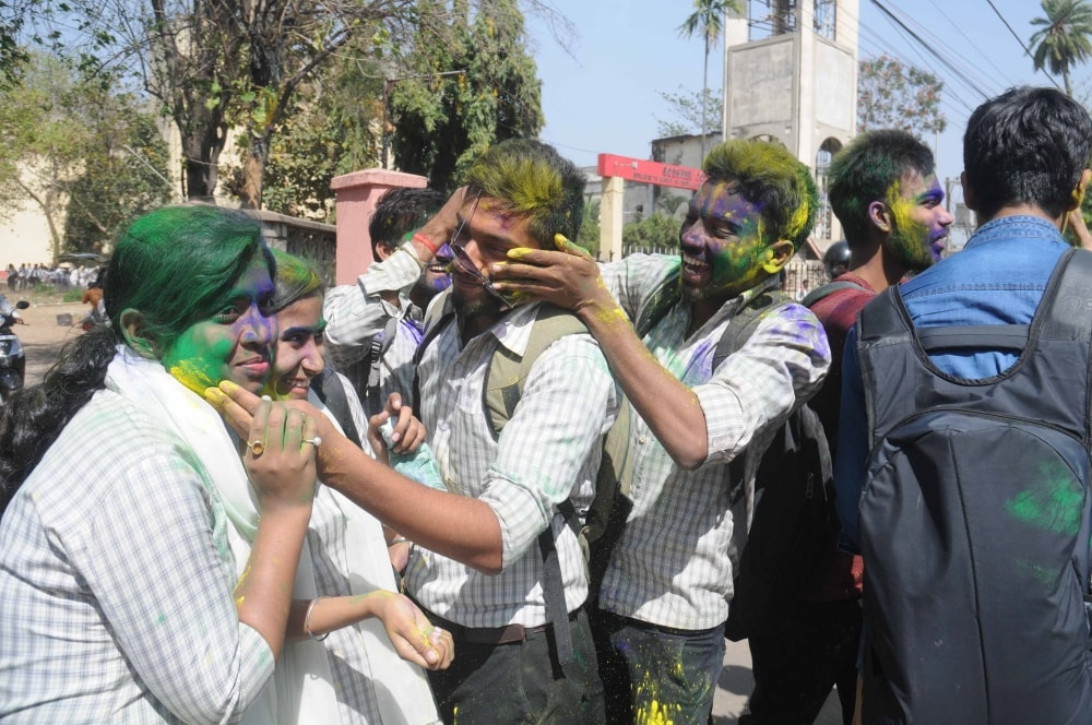 <p>College students play with 'Gulal' during Holi celebrations in Ranchi on Monday.</p>