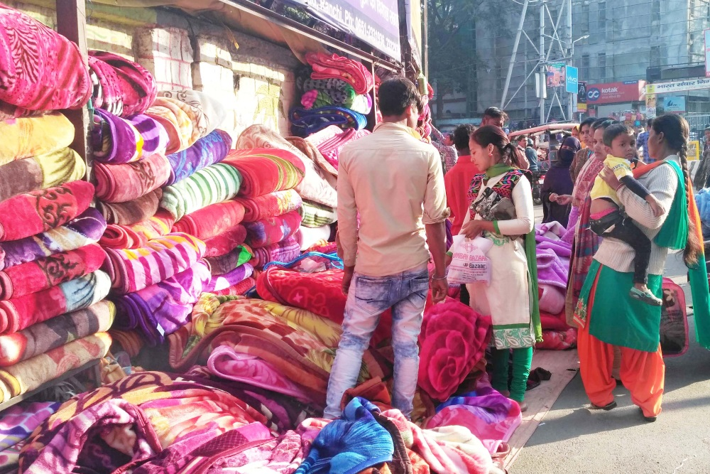 <p>A street vendor selling woolen blankets near Albert Ekka Chowk in Ranchi on Monday.</p>