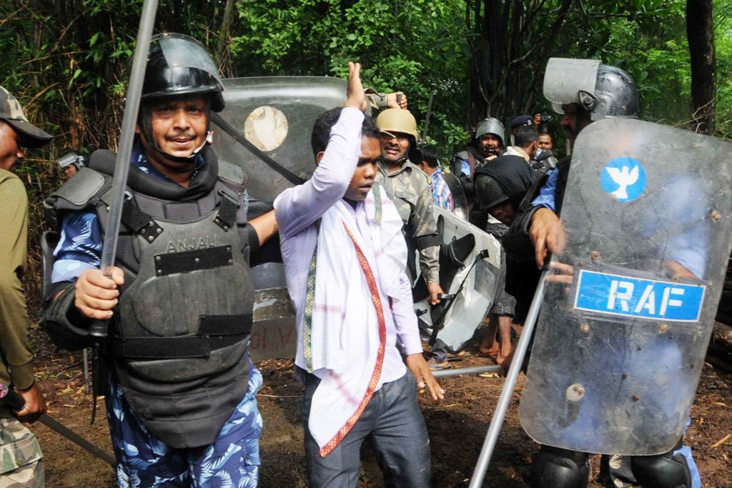 <p>Security personnel detain villagers while carrying out a search operation at the remote village Ghagra, where Member of Parliament (MP) Karia Munda's three bodyguards, belonging…