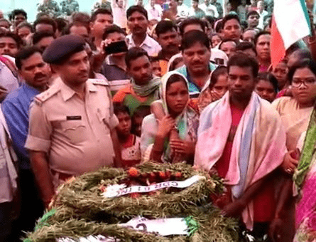 <p>With tears in their eyes, scores of villagers took part in last rites performed on the body of the Martyr Santosh Gop, a BSF jawan. Gop was paid tribute by hundreds of people at…