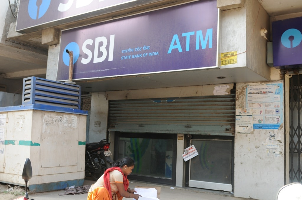 "<p>A women is seen busy near an ""out of service"" ATM machine in Ranchi on Tuesday. Several ATM's on Tuesday ran out of cash in the city.</p>"