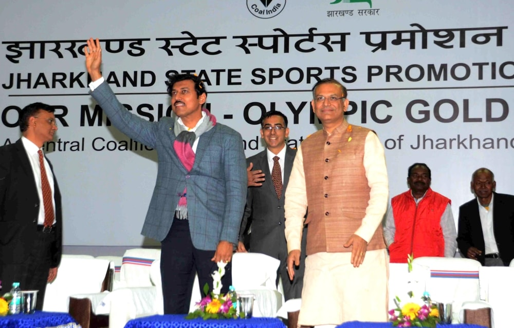 <p>Union Minister of youth Affairs and Sports Rajyavardhan Singh Rathore waves to players during the sports programme on ''Our Mission-Olympic Gold Medals'' at Mega…