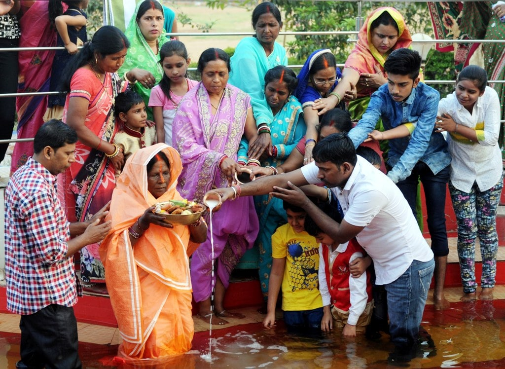 <p>Devotees performing rituals during Chhaiti Chhath Puja festival in Ranchi on Friday. </p>