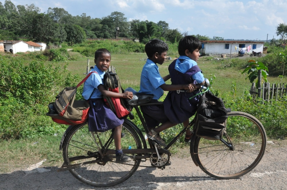 <p>On the occasion of Rakhshabandhan,three school children with a kid move around by a bicycle in the outskirt Ranchi.</p>