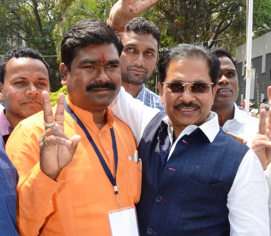 <p>BJP nominated candidate Sameer Oraon (L) and Congress nominated candidate Dheeraj Sahu flashes victory sign after being elected as new MP of Rajya Sabha in Ranchi on Friday. </p>…