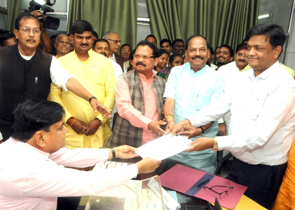 <p>Candidate for Bharatiya Janta Party (BJP) Pradeep Kumar Sonathalia filing his nomination papers for Rajya Sabha polls as Chief Minister Raghubar Das and State President Laxman Gilua,…