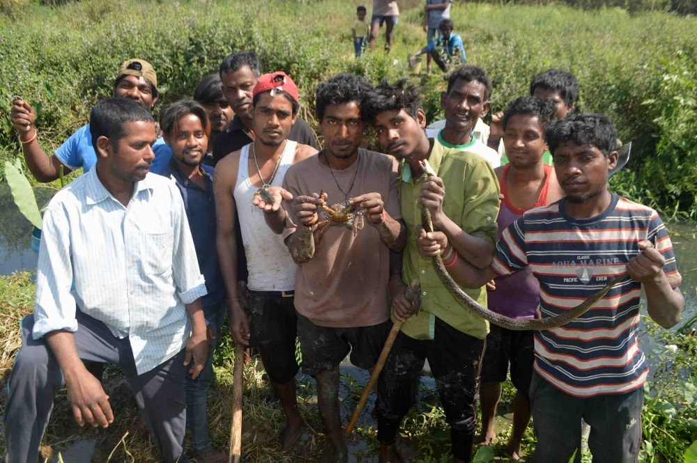 <p>Tribal priests showing craves on the eve of the Sarhul festival in Ranchi on Monday. Age-old custom of catching some crave and fish, which were also offered as prayer, smashed and…