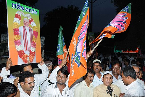 BJP workers celebrate in Ranchi as Modi declared its PM candidate in New Delhi
