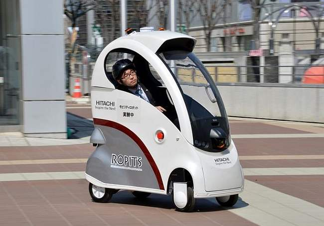Hitachi unveils one- man electric car