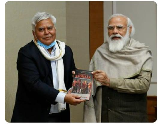 rs-sharma-presents-his-book-to-pm-narendra-modi
